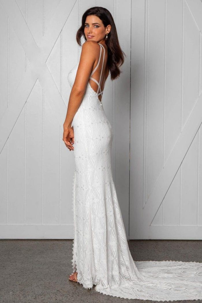 Side shot of brunette bride wearing Grace Loves Lace Leon Gown looking over shoulder