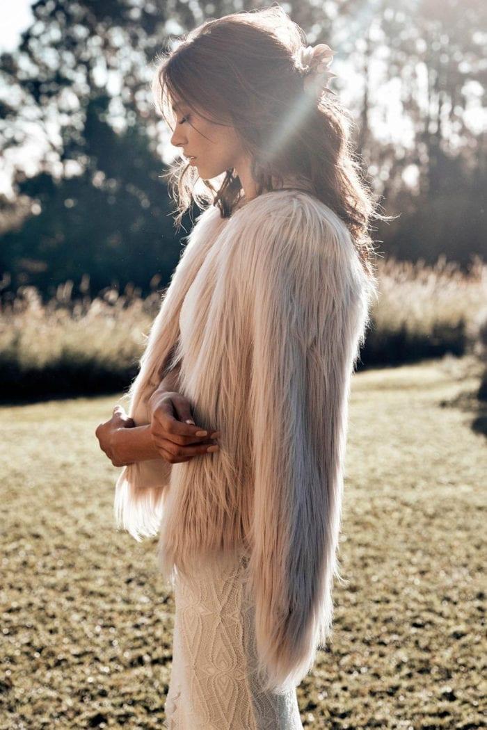 Brunette bride wearing Grace Loves Lace Leon Gown and fur coat
