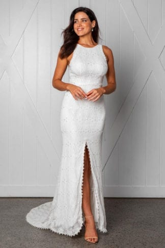 Brunette bride wearing Grace Loves Lace Leon Gown looking to the side