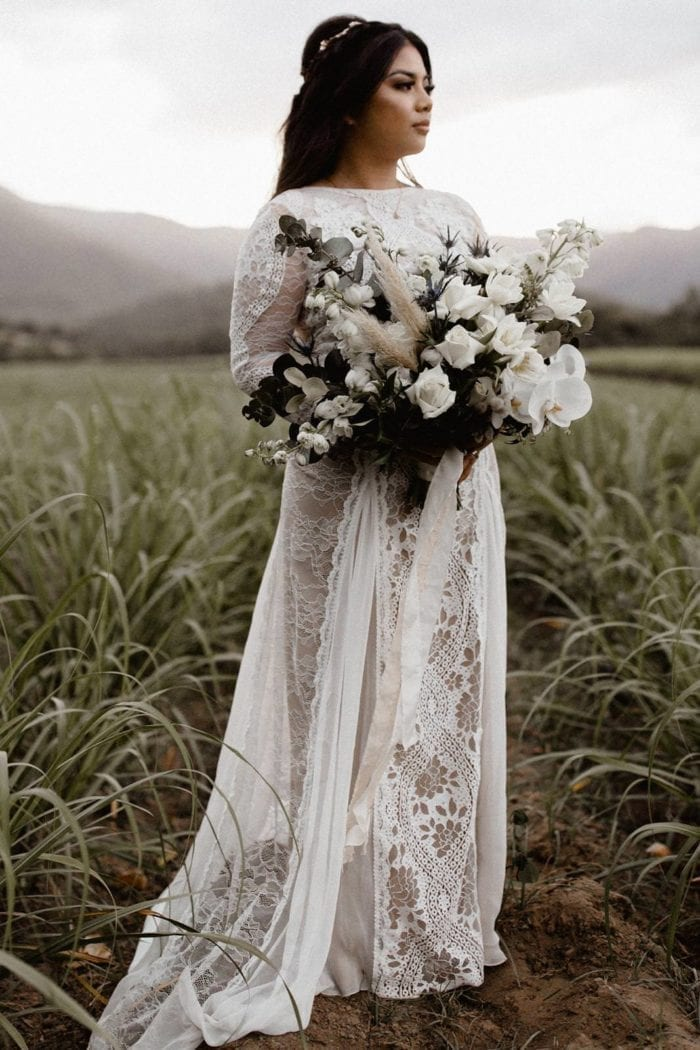 Bride wearing Grace Loves Lace Inca Gown holding bouquet