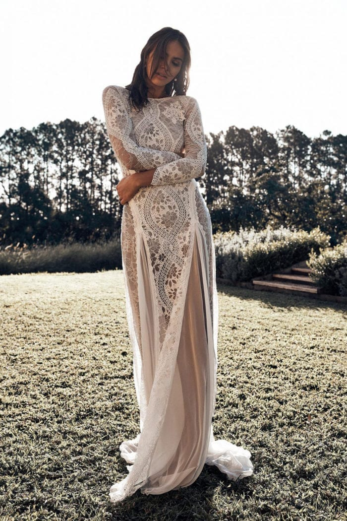 Bride wearing Grace Loves Lace Inca Gown with hands on waist