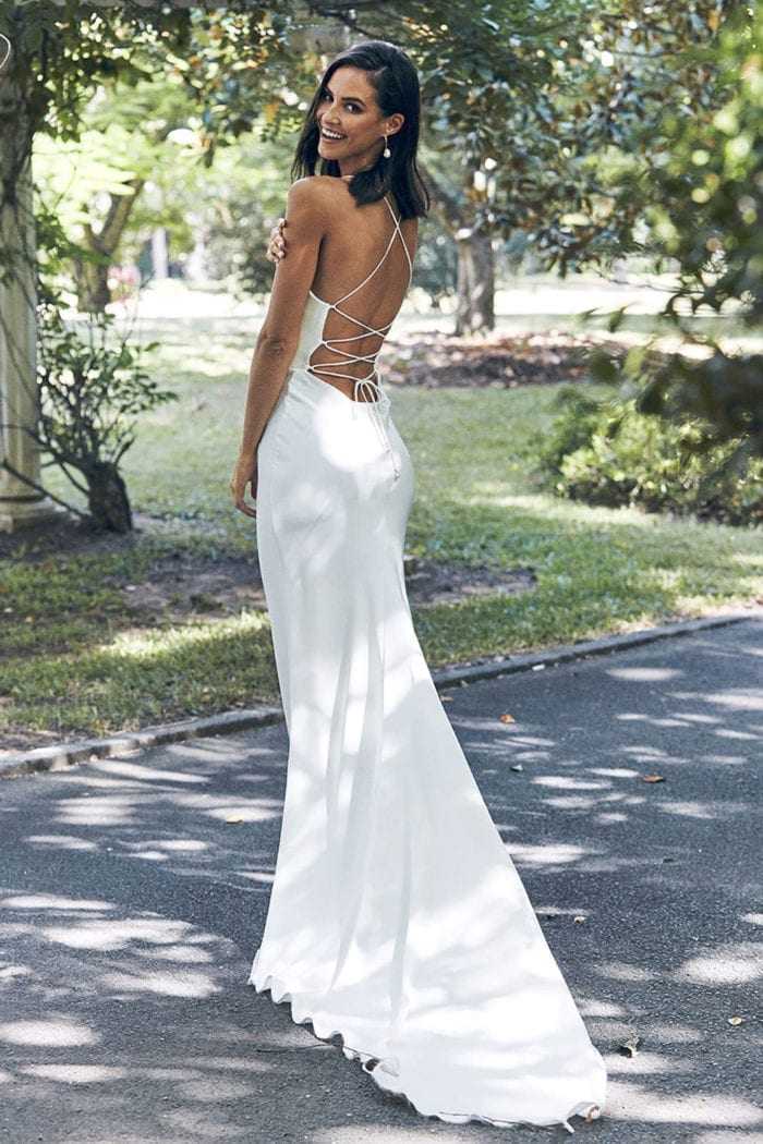 Back shot of bride wearing Grace Loves Lace Honey Silk Gown looking over shoulder