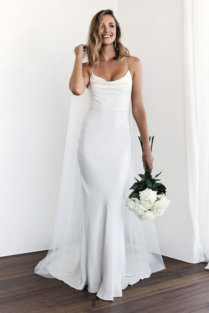 Bride wearing Grace Loves Lace Honey Silk Gown holding bouquet