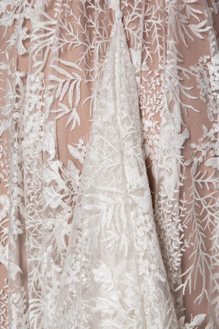 Close-up of Grace Loves Lace Harri Gown skirt detail