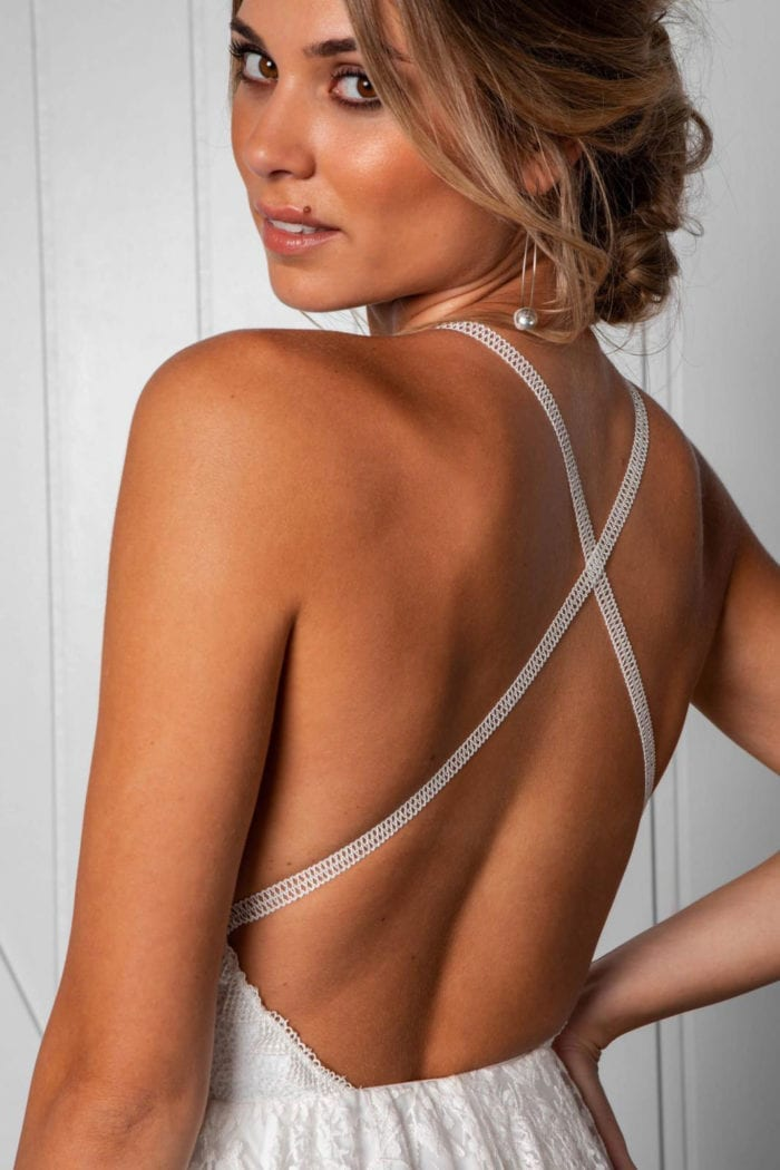 Close-up of back shot of blonde bride wearing Grace Loves Lace Harri Gown