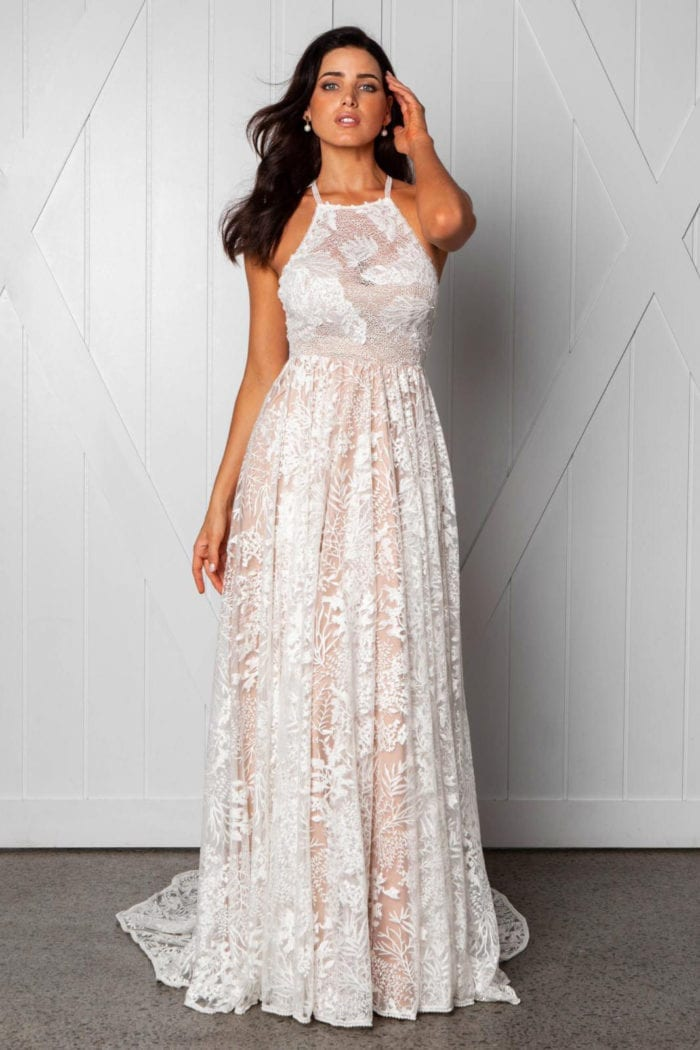 Brunette bride wearing Grace Loves Lace Harri Gown with hand on hair