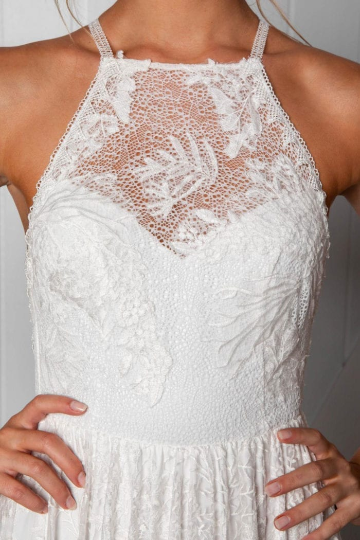 Close-up of bride wearing Grace Loves Lace Harri Gown with hands on hips