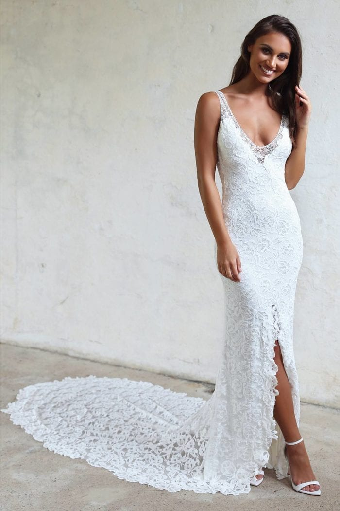 Brunette bride wearing Grace Loves Lace Gia Gown with hand on hair