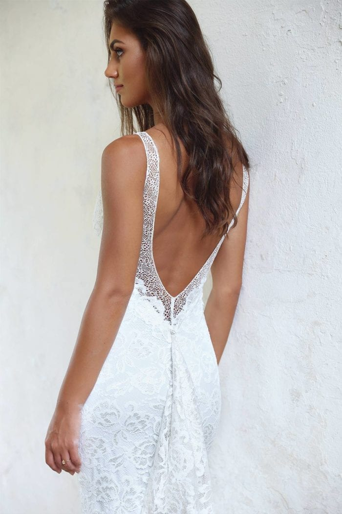 Back shot of brunette bride wearing Grace Loves Lace Gia Gown