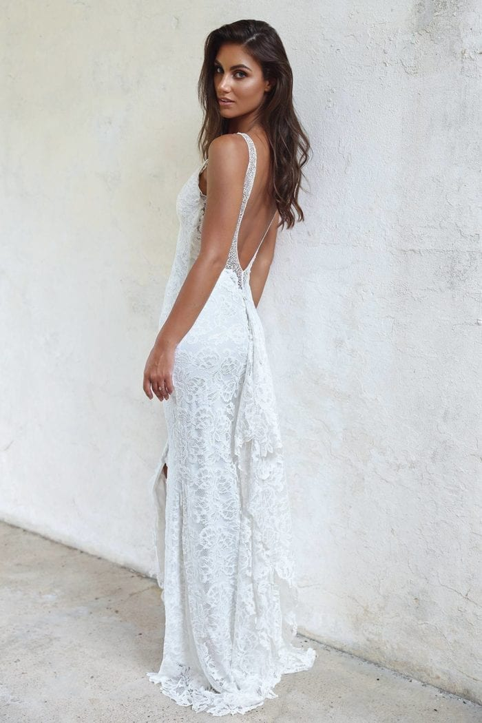 Brunette bride wearing Grace Loves Lace Gia Gown looking over shoulder