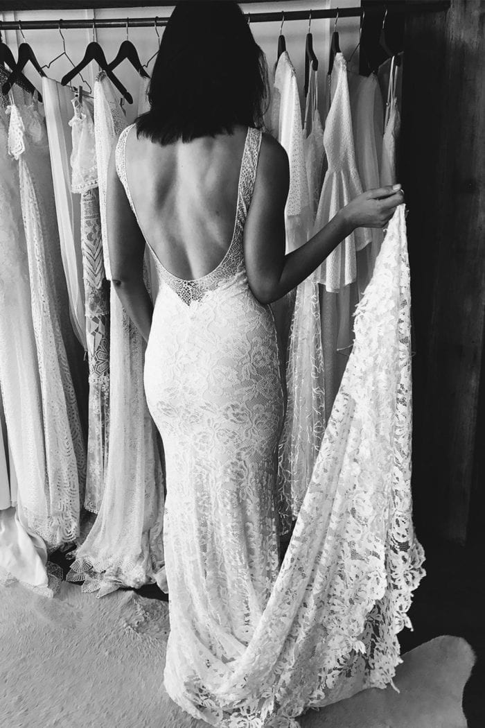 Back shot of bride wearing Grace Loves Lace Gia Gown holding bouquet
