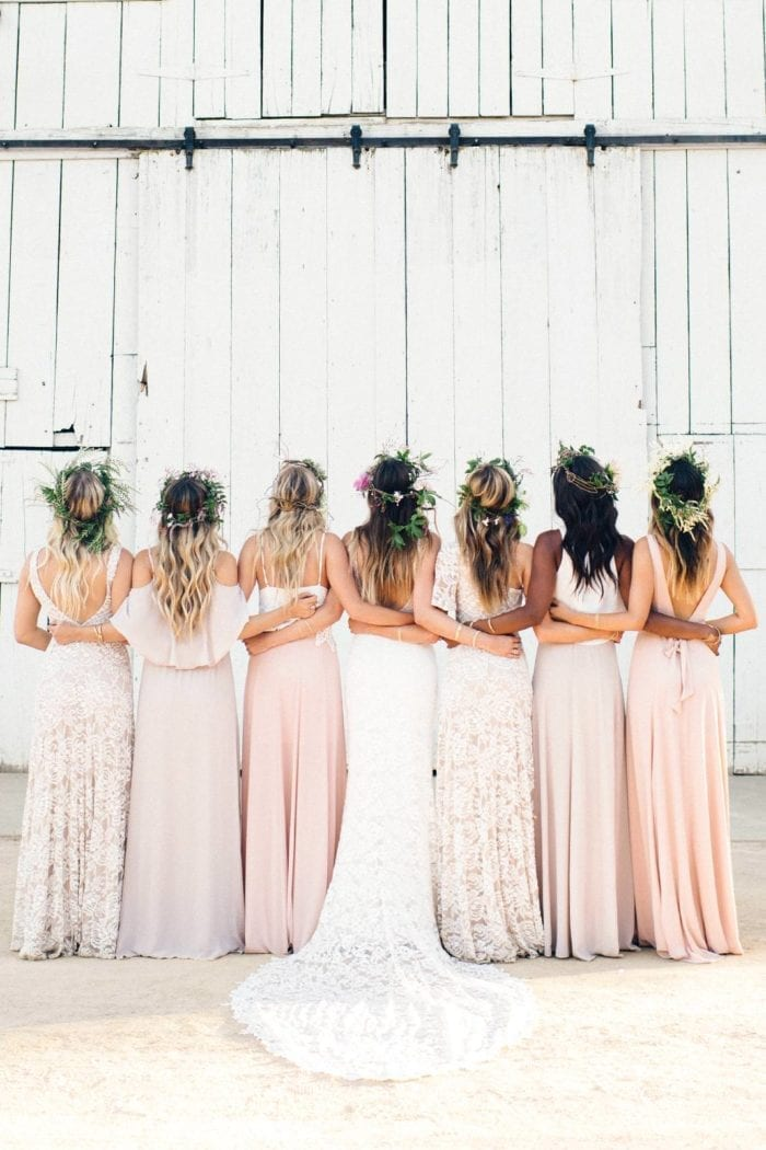 Back shot of bride wearing Grace Loves Lace Gia Gown standing with bridesmaids