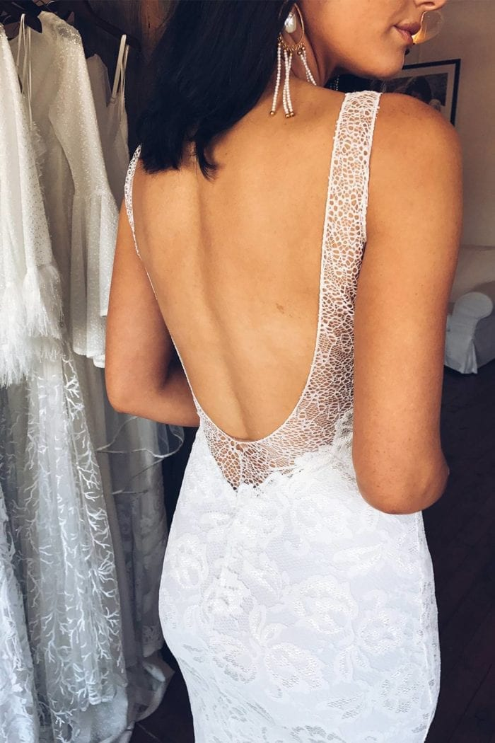 Back shot of bride wearing Grace Loves Lace Gia Gown