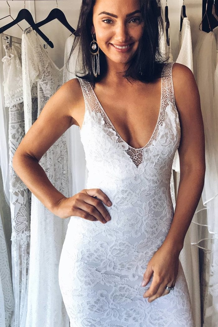 Brunette bride wearing Grace Loves Lace Gia Gown with hand on hip