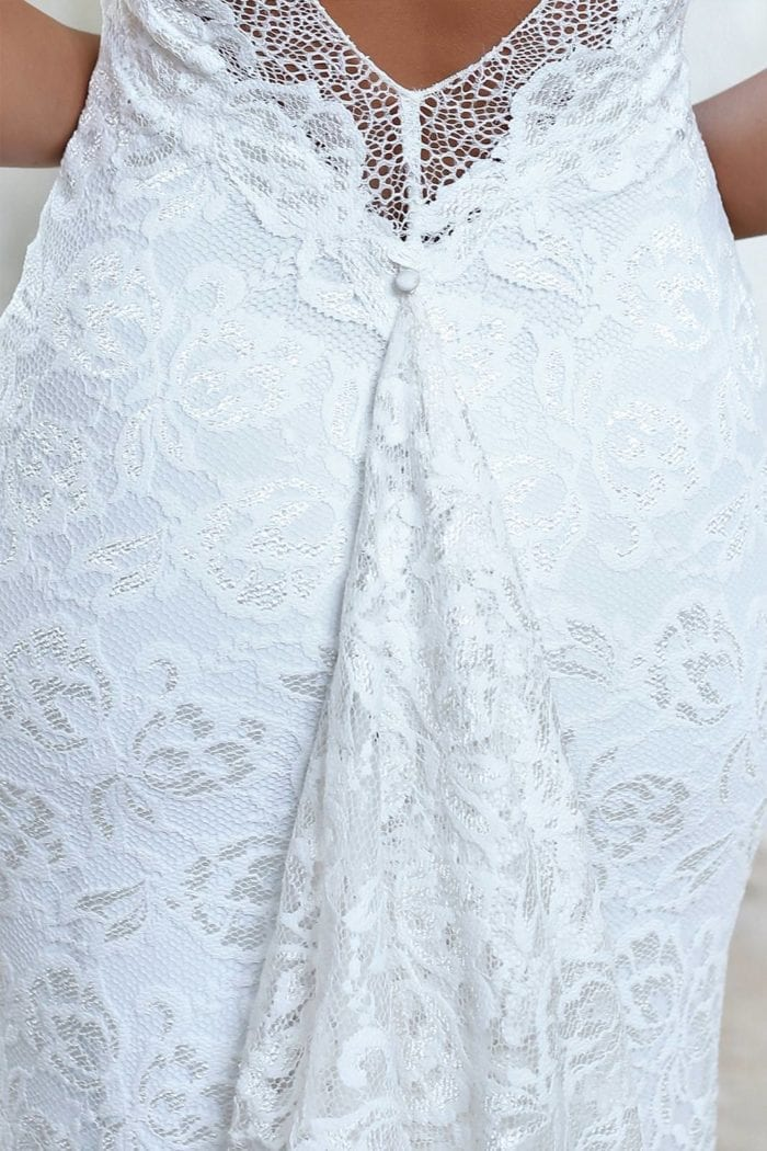 Close-up of bride wearing Grace Loves Lace Gia Gown showing train buttoned up