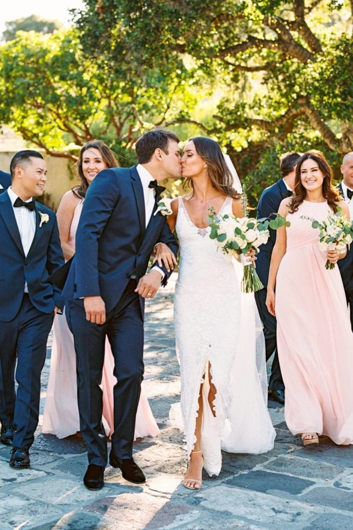 Blonde bride wearing Grace Loves Lace Gia Gown kissing groom