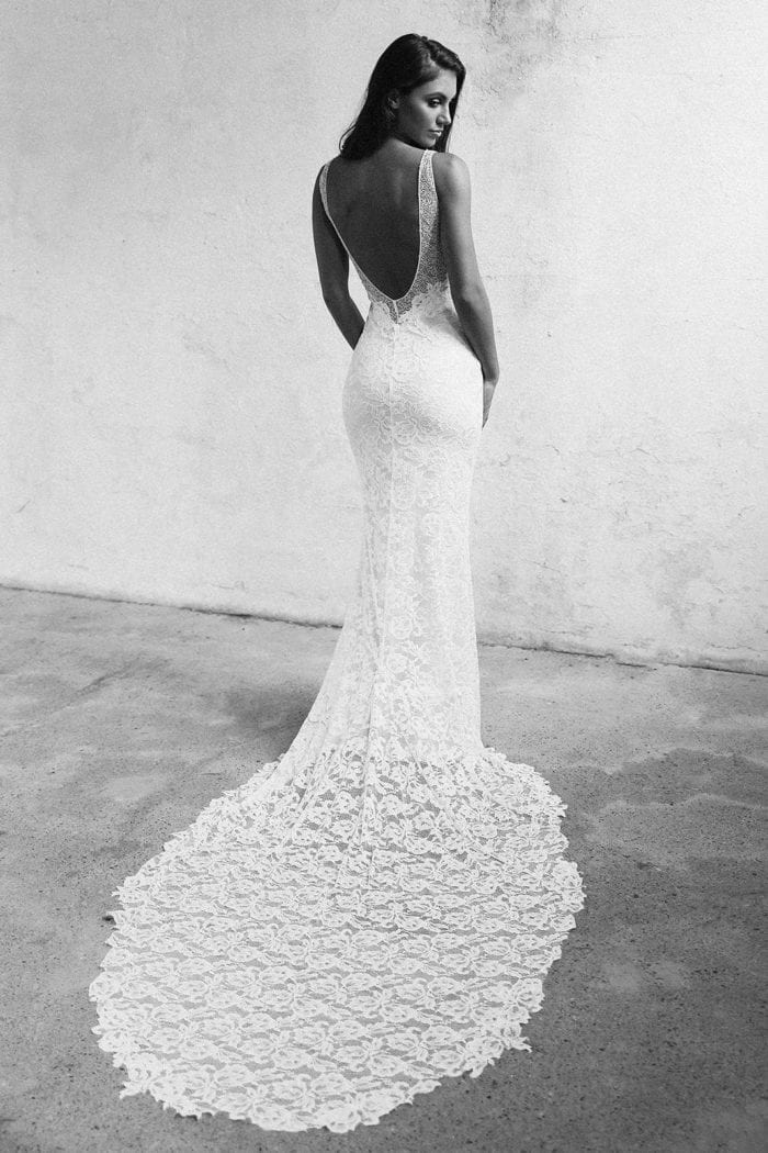 Black and white shot of bride wearing Grace Loves Lace Gia Gown