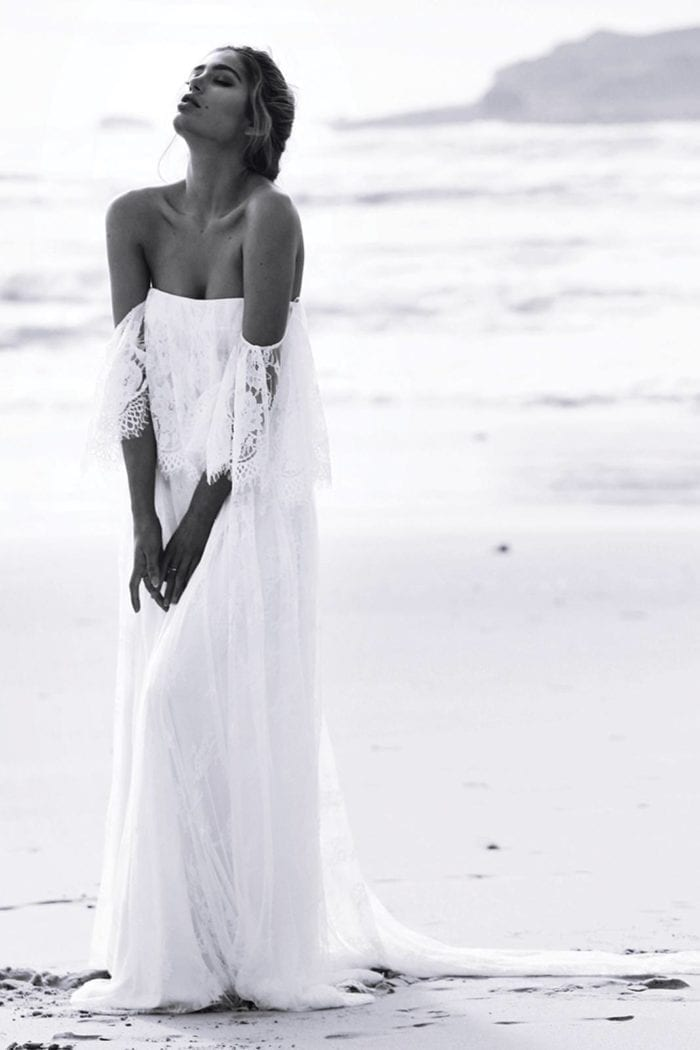 Black and white shot of bride wearing Grace Loves Lace Florence Gown in Ivory on beach