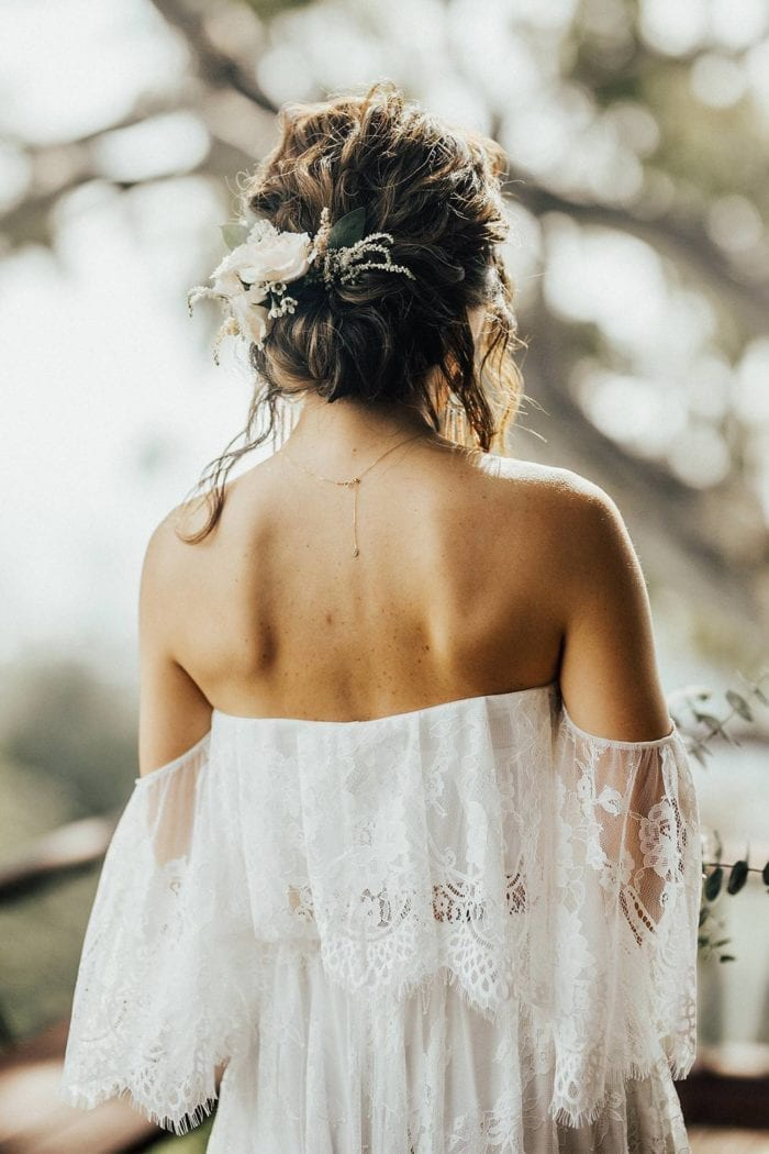 Back shot of brunette bride wearing Grace Loves Lace Florence Gown in Ivory