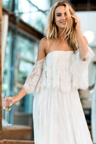 Blonde bride wearing Grace Loves Lace Florence Gown in Ivory holding champagne glass