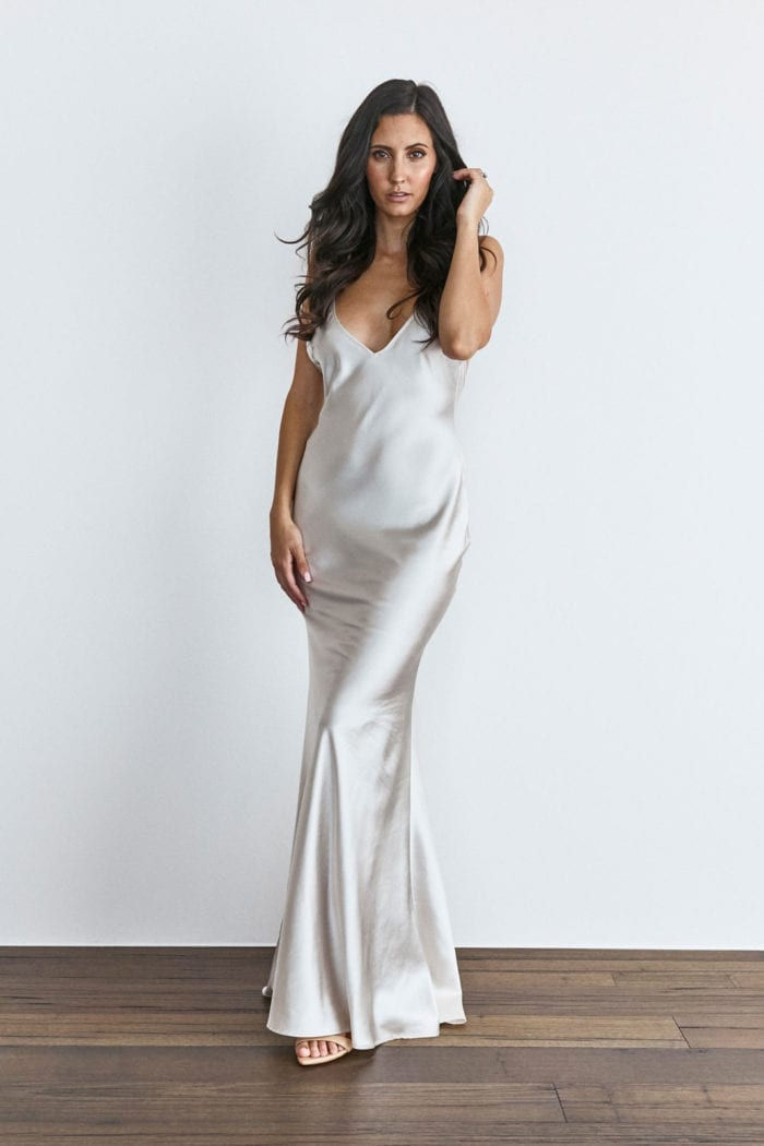 Brunette bridesmaid wearing Grace Loves Lace Farrow Slip Gown with hand on hair