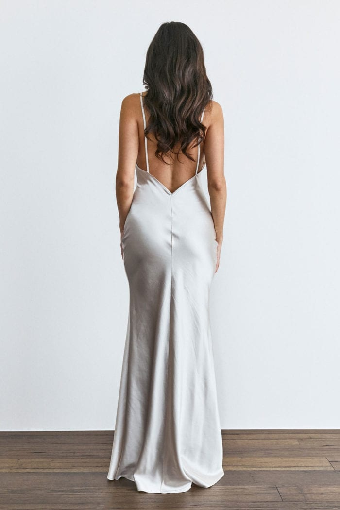 Back shot of bridesmaid wearing Grace Loves Lace Farrow Slip Gown
