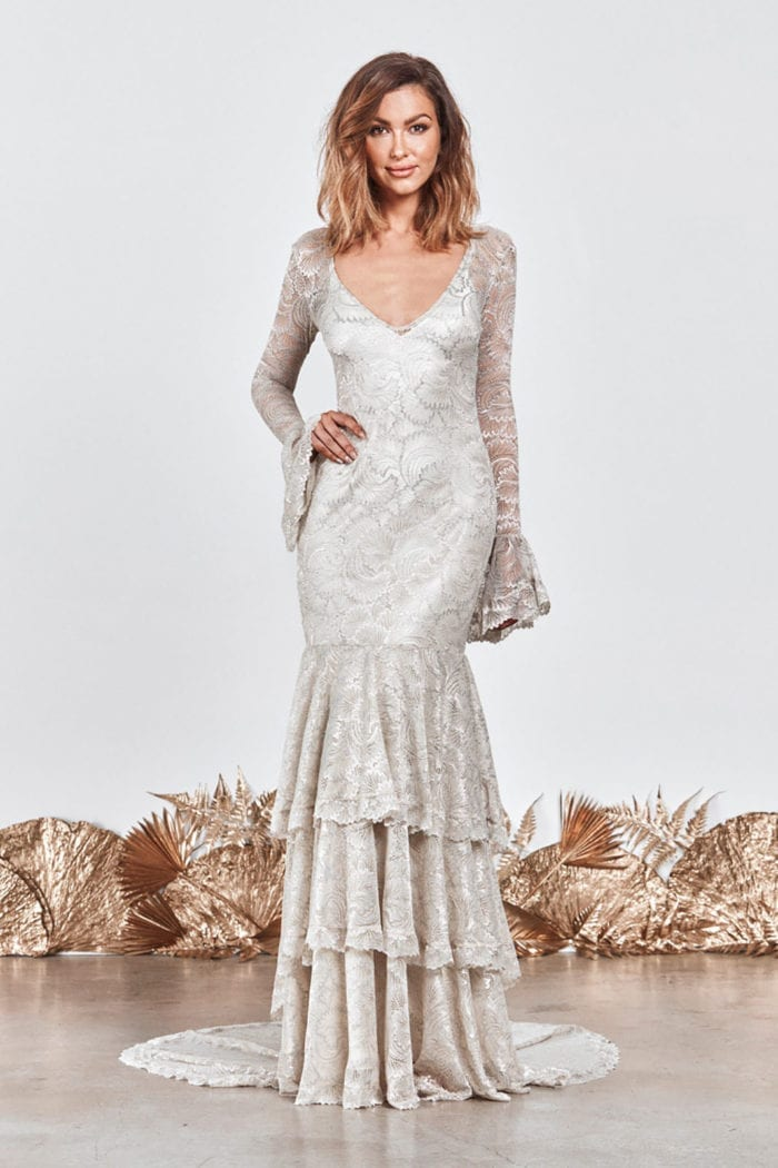 Brunette bride wearing Grace Loves Lace Farrow Gown with hand on hip