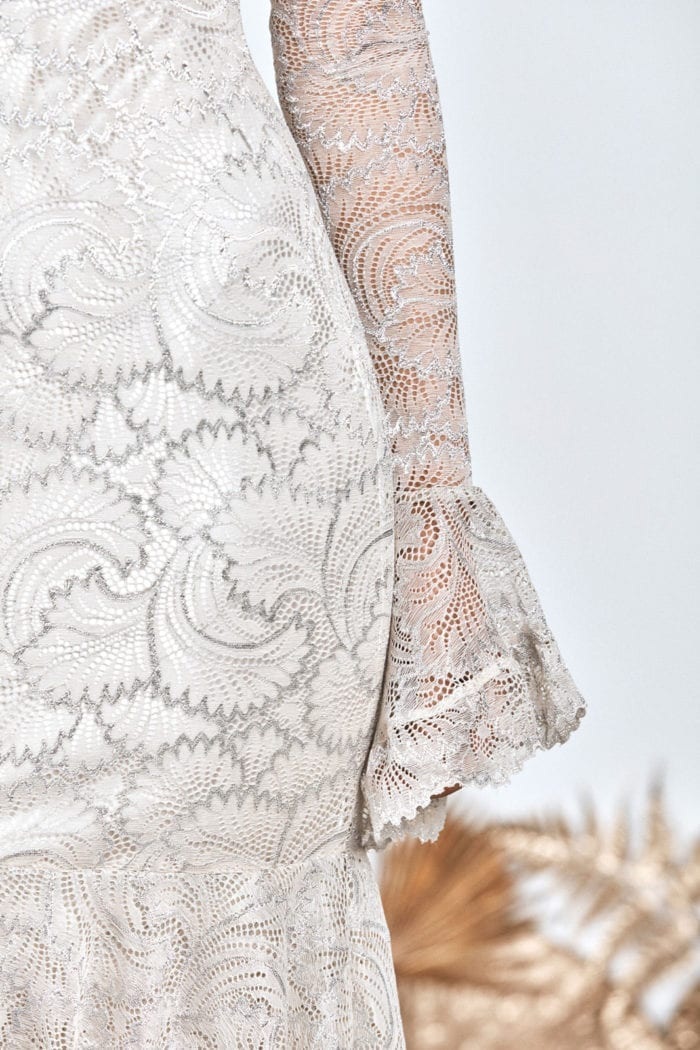 Close-up of bride wearing Grace Loves Lace Farrow Gown showing skirt and sleeve detail