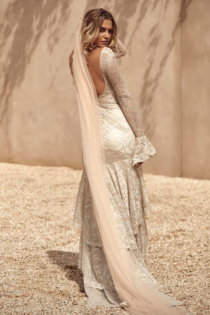 Back shot of bride wearing Grace Loves Lace Farrow Gown and veil