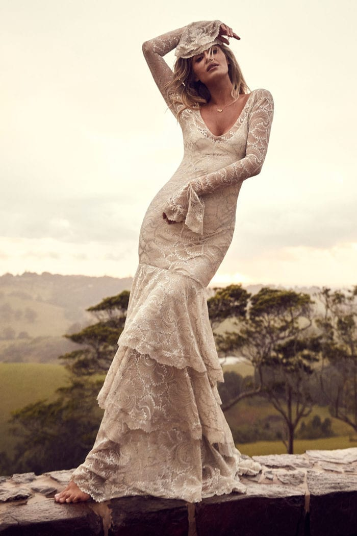 Blonde bride wearing Grace Loves Lace Farrow Gown with arm above head