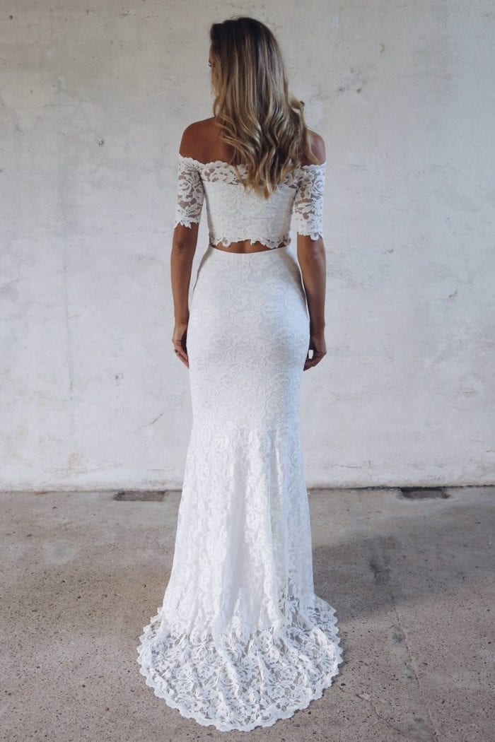 Back shot of bride wearing Grace Loves Lace Everly Gown looking to the side