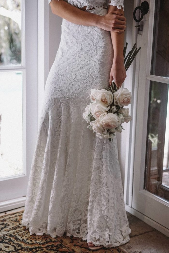 Bride wearing Grace Loves Lace Everly Gown holding bouquet