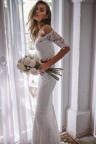 Brunette bride wearing Grace Loves Lace Everly Gown holding bouquet