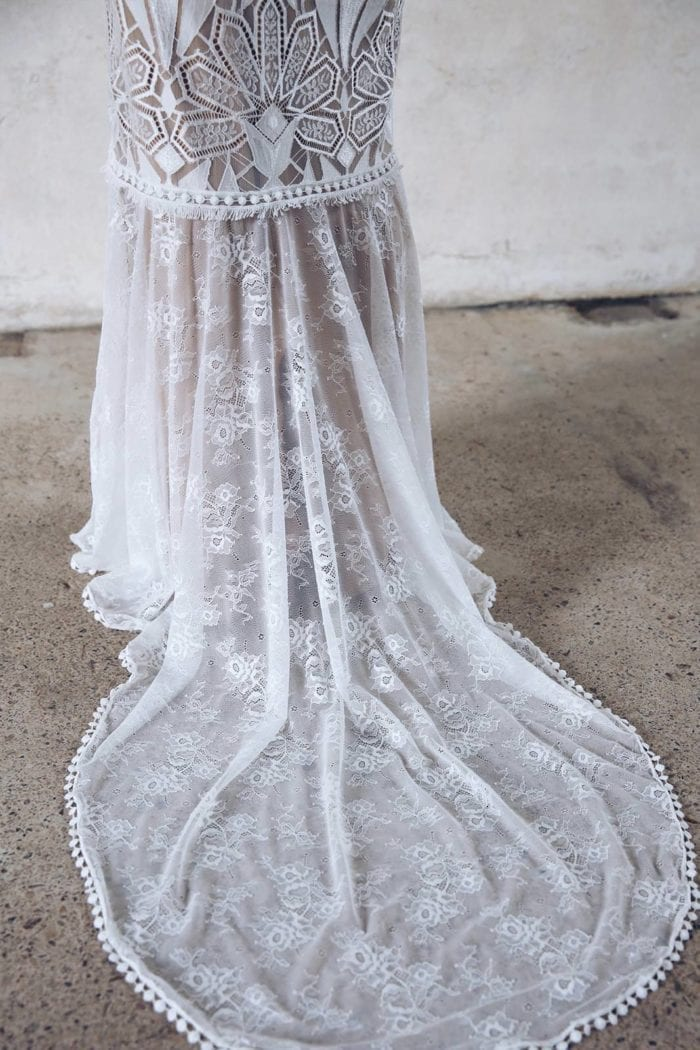 Close-up of Grace Loves Lace Emanuela Gown showing train and skirt detail