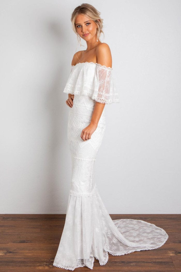 Blonde bride wearing Grace Loves Lace Emanuela Gown with hand on hip