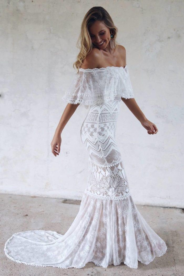 Blonde bride wearing Grace Loves Lace Emanuela Gown looking over shoulder