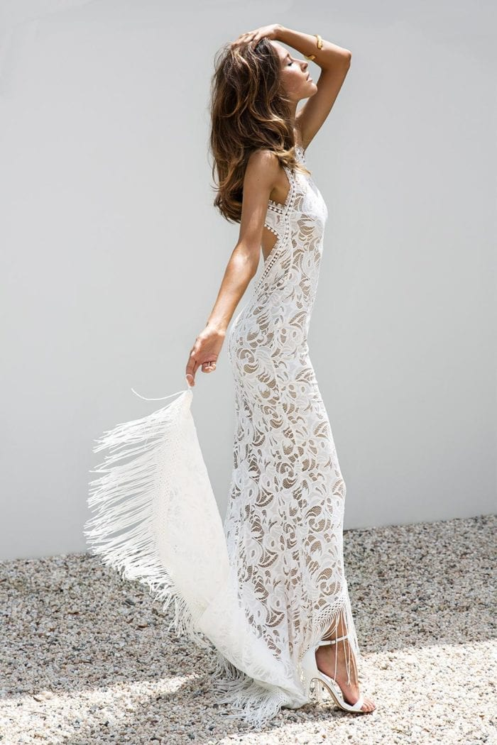 Brunette bride wearing Grace Loves Lace Edie Gown holding train in one hand