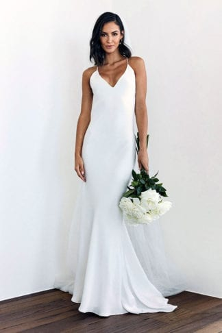 Brunette bride wearing Grace Loves Lace Dove Gown holding bouquet