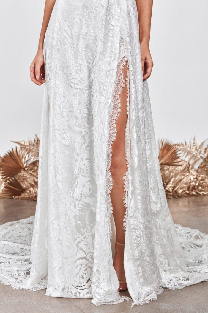 Close-up of bride wearing Grace Loves Lace Darling Gown showing skirt split