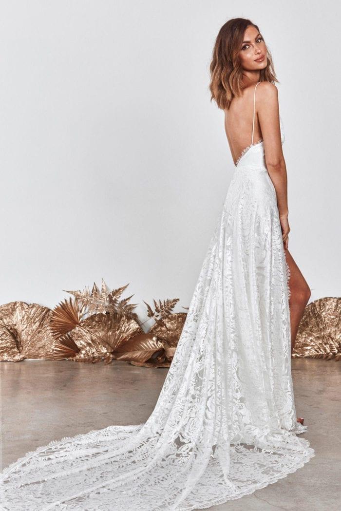 Back shot of brunette bride wearing Grace Loves Lace Darling Gown looking over shoulder