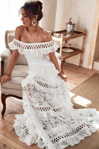 Brunette bride wearing Grace Loves Lace Coco Gown sitting on armchair
