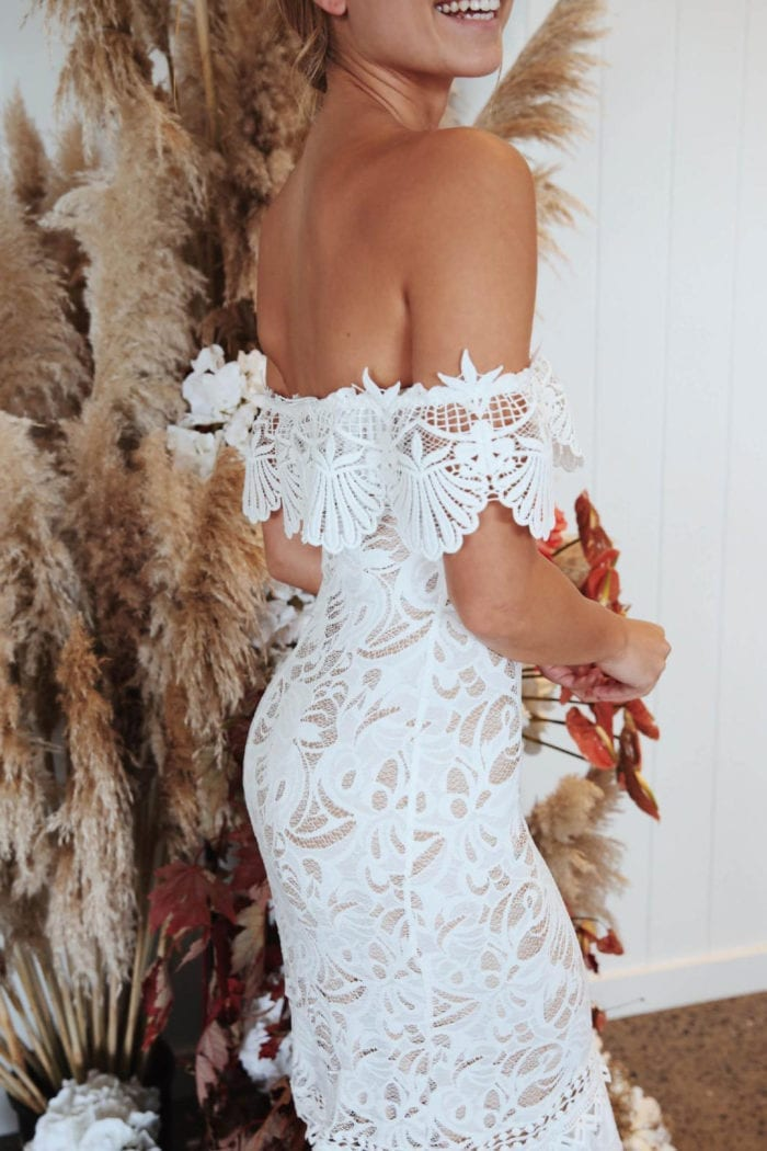 Back shot of bride wearing Grace Loves Lace Cien Gown