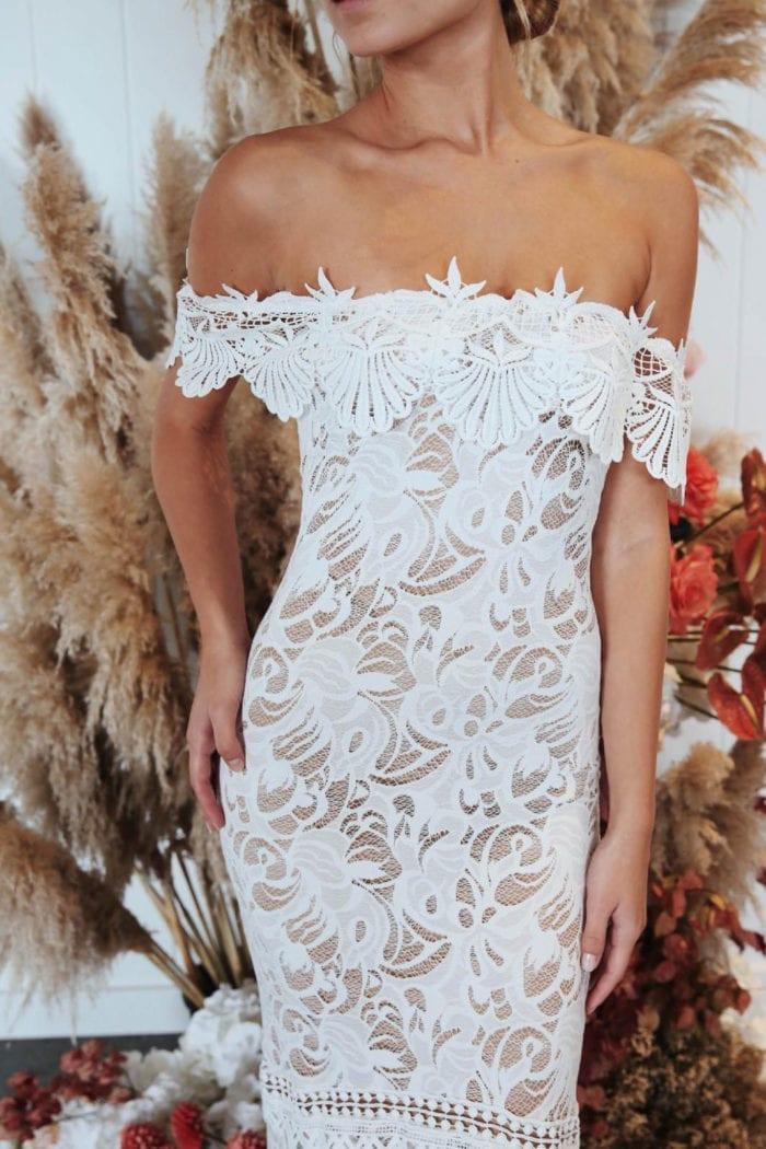 Torso-shot of bride wearing Grace Loves Lace Cien Gown
