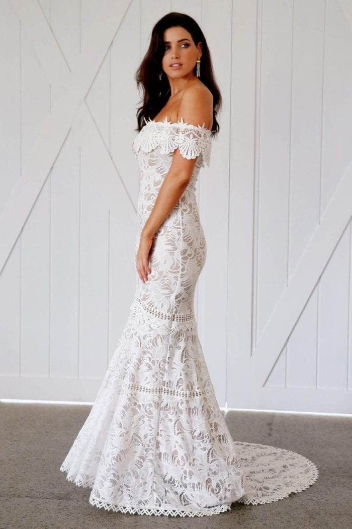 Brunette bride wearing Grace Loves Lace Cien Gown looking to the side