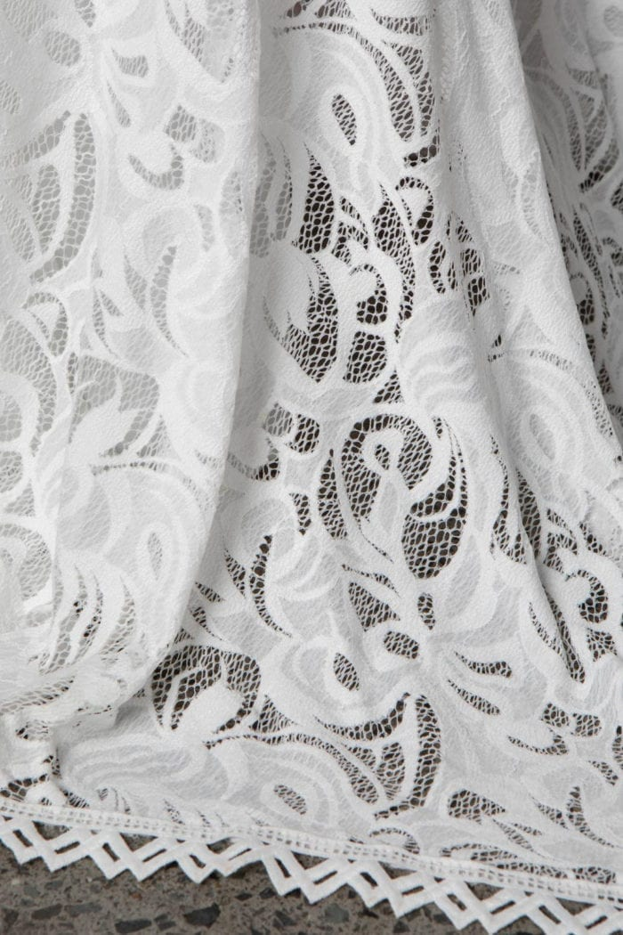 Close-up of Grace Loves Lace Cien Gown showing skirt detail