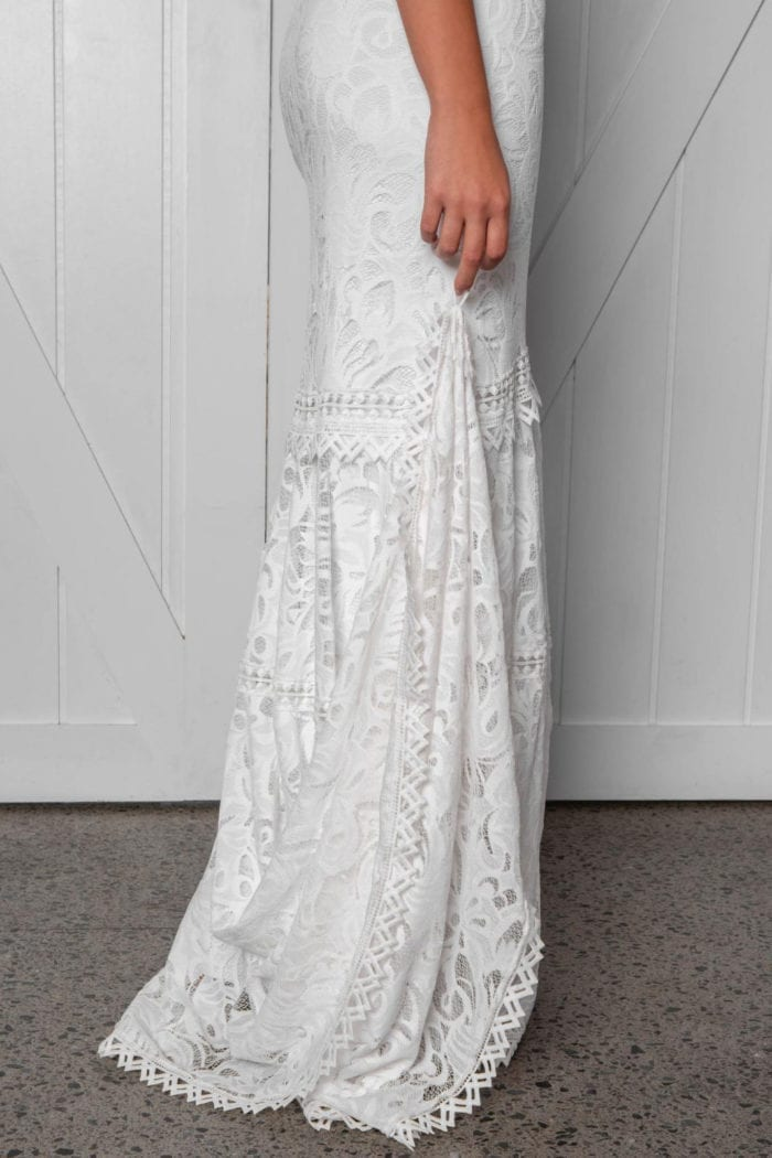 Close-up of bride wearing Grace Loves Lace Cien Gown showing train finger loop