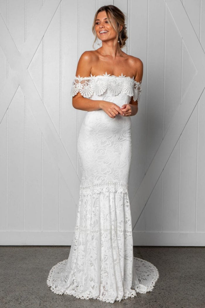 Blonde bride wearing Grace Loves Lace Cien Gown
