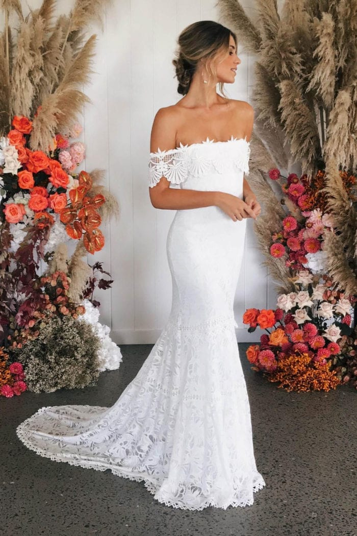 Blonde bride wearing Grace Loves Lace Cien Gown looking to the side