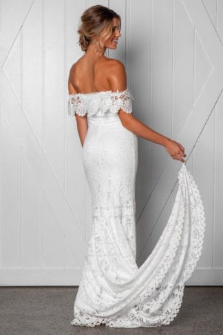 Back shot of bride wearing Grace Loves Lace Cien Gown looking to the side with finger in finger loop