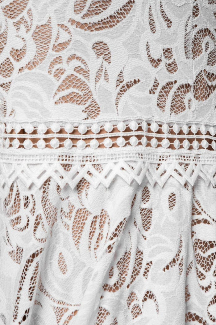 Close-up of Grace Loves Lace Cien Gown showing trim, hem and skirt detail